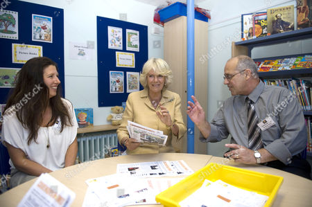 Camilla Duchess of Cornwall with helpers Suzanne Diver and David De Cruz