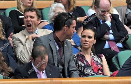 England cricketer Kevin Pietersen looks on from the Royal Box alongside his wife Jessica Taylor as former England captain Mike Atherton yawns