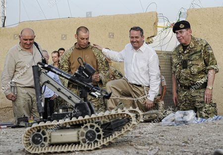 Liam Fox with members of 3 Commando Brigade and first Sealord Admiral Sir Mark Stanhope in Helmand Province