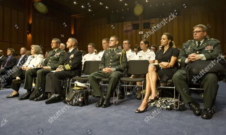 Author Paula Broadwell (R) and Holly Petraeus (L in white) sit in the front row during the confirmation hearing of US Army General David Petraeus on Capitol Hill in Washington, DC before the Senate Select Committee on Intelligence for his confirmation hearing as the next Director of the Central Intelligence Agency