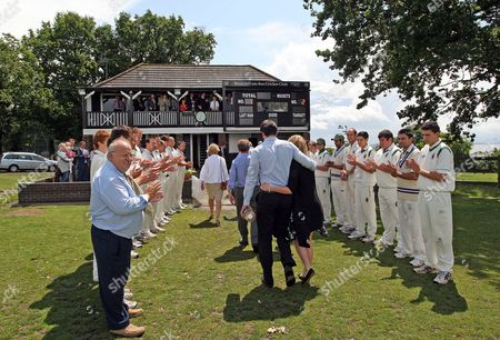 Members and players of Westcliff on Sea and Harlow cricket clubs form a guard of honour for family members after the scattering of his ashes