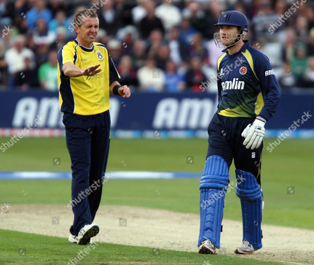 Stock Picture of Dominic Cork of Hampshire apologises to Tim Phillips of Essex after hiting him with a wayward throw
