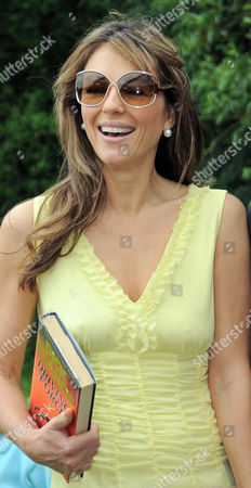 Elizabeth Hurley purchases a Dick Francis novel from the second hand bookstall