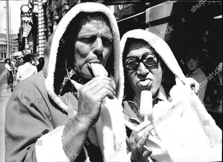 Comedians Dickie Henderson (l) And Arthur Askey Eating Ice Lollies Dressed As Father Christmas. Henderson Died 9/1985 Askey Died 11/1982.