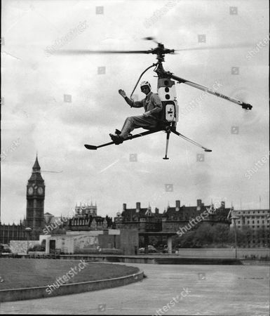 Major Richard Peck Gives A Wave On Landing A Rotorcycle A One-man Helicopter At The Southbank.