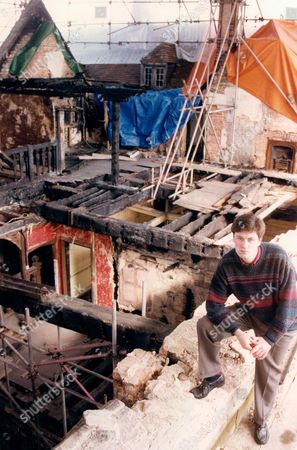 Patrick Cooke With The Fire Damaged Area Of The Manor Over Looking The State And Yellow Rooms At Athelhampton Manor Dorset