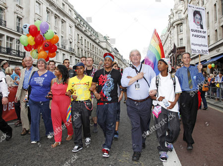 Richard Barnes, Deputy Mayor of London waving a rainbow flag in the London Gay Pride Parade 2011