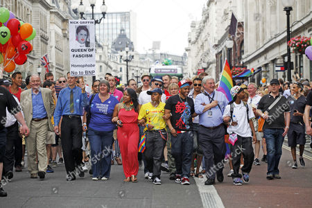 Richard Barnes, Deputy Mayor of London waving a rainbow flag and Ken Livingstone in the London Gay Pride Parade 2011