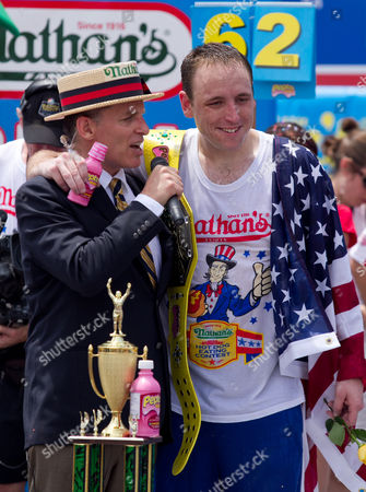 Stock Image of Joey 'Jaws' Chestnut maintained pigout primacy Monday, winning his fifth straight mustard belt in Coney Island's hot dog eating contest.