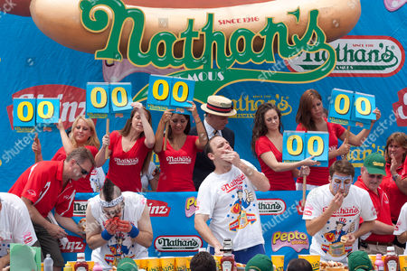Joey 'Jaws' Chestnut (center) maintained pigout primacy Monday, winning his fifth straight mustard belt in Coney Island's hot dog eating contest.