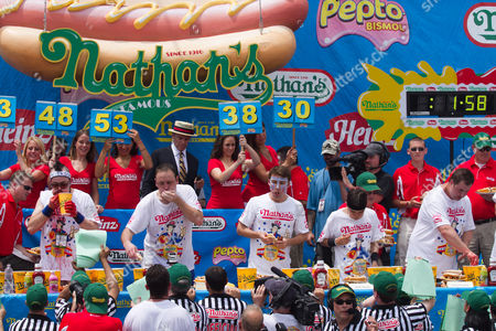 Joey 'Jaws' Chestnut (2nd from left) maintained pigout primacy Monday, winning his fifth straight mustard belt in Coney Island's hot dog eating contest.