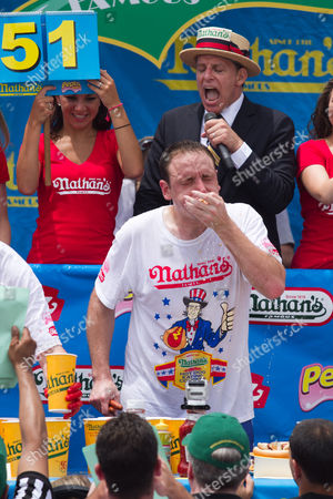 Joey 'Jaws' Chestnut maintained pigout primacy Monday, winning his fifth straight mustard belt in Coney Island's hot dog eating contest.