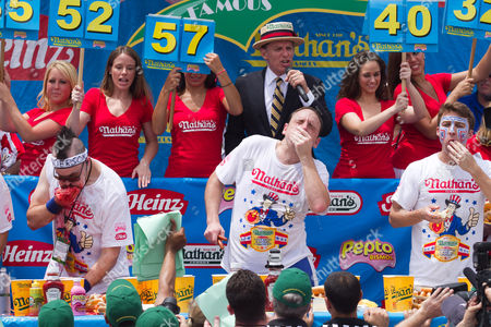 Stock Picture of Joey 'Jaws' Chestnut (center) maintained pigout primacy Monday, winning his fifth straight mustard belt in Coney Island's hot dog eating contest.