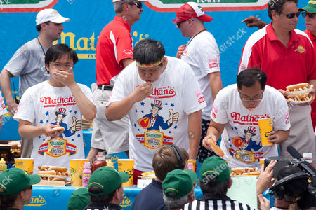 Stock Photo of Joey 'Jaws' Chestnut maintained pigout primacy Monday, winning his fifth straight mustard belt in Coney Island's hot dog eating contest.