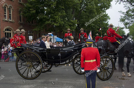 Stock Picture of Prince William and Catherine Duchess of Cambridge ride in a landau with Premier Robert Ghiz and his wife Kate Ellis Ghiz