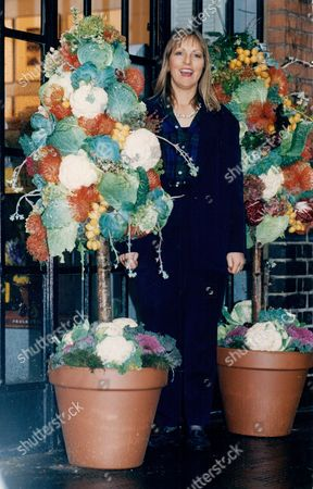 Florist Paula Pryke With One Of Her Flower And Vegetable Displays.