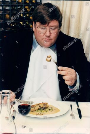 Food Critic Charles Campion Eating A Sausage With Truffles Meal.