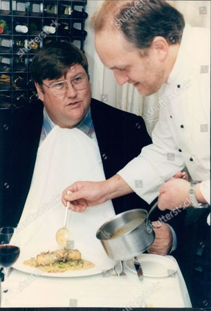 Chef Alex Aitken Serving Food Critic Charles Campion A Sausage With Truffles Meal.