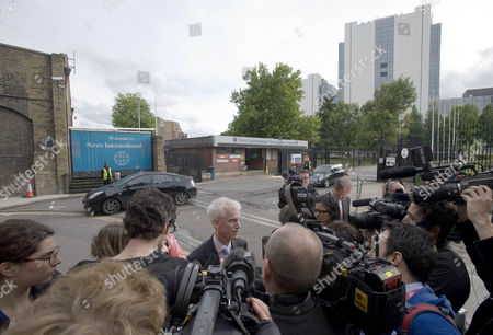The News of the World's political editor, David Wooding talking to media outside News International.