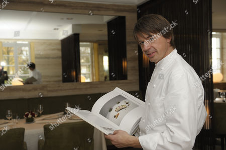 Three-star chef Joachim Wissler with his new cookbook, Vendome Restaurant, Grand Hotel Schloss Bensberg, Bergisch Gladbach-Bensberg, North Rhine-Westphalia, Germany, Europe