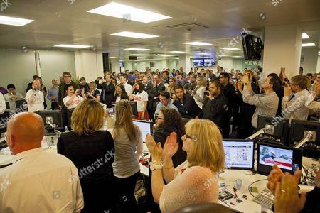 Staff applauding