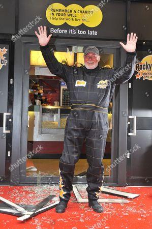 Rocky Taylor after jumping through a sugar glass door frame