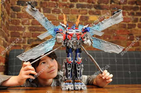 Mylo with Transformers Ultimate Optimus Prime toy
