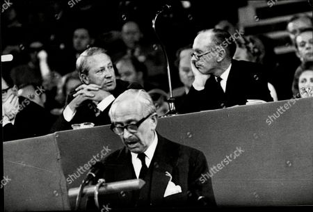 Conservative Party Conference 1965. Lord Salisbury Speaks Behind Him Sir Alec Douglas-home And Sir Edward Heath Exchange Glances.