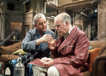 David Tomlinson as Sir John Holt and Richard Vernon as Sir Lionel Hibury