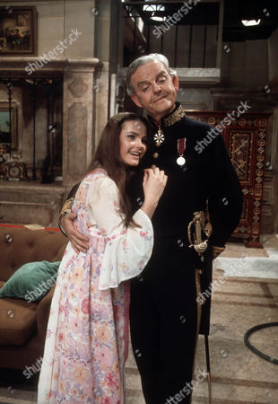 Fiona Fullerton as Sheila Hibury and David Tomlinson as Sir John Holt