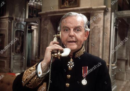 David Tomlinson as Sir John Holt