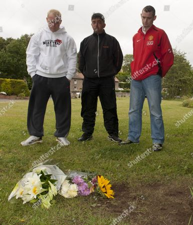 Friends Of Raoul Moat Lay Flowers At The Spot Where The Fugutive Shot Himself In Rothbury. Left To Right Are David Mccluskey Paul Sim And Stephen Mccluskey All From Seaton Down.