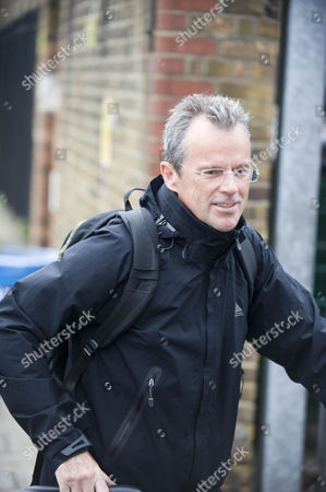 Stock Picture of Mark Elms The Head Teacher Of Tidemill Primary School In Depford London Is Seen Arriving By Bike At His School. It Has Been Reported That He Earns More Money Than The Prime Minister.