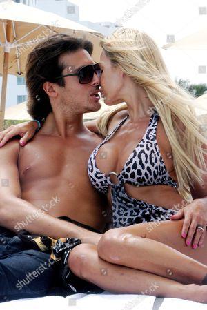 Editorial image of Playboy Playmate Shauna Sand with husband Laurent Homburger at Miami Beach, Florida, America - 14 Jul 2011
