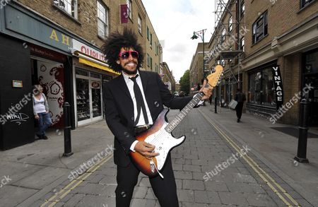 Busker Lewis Floyd Henry In Brick Lane Where He Was Spotted And Picked To Play At Festivals This Summer Photograph By Glenn Copus
