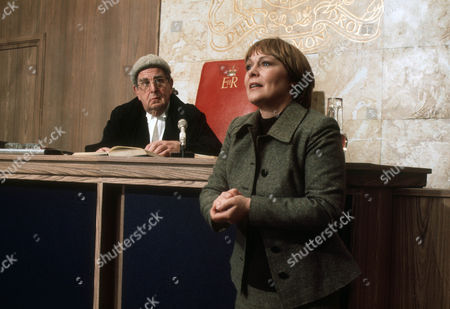 Stock Photo of Robert Morley as Mr Justice Bosanquet and Zena Walker as Jenny Rastall