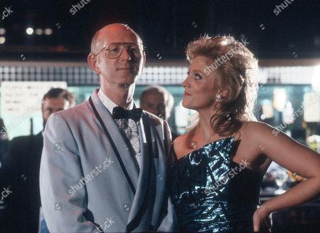 Stock Photo of Ken Drury as Reg Bartelli and Janette Beverley as Charmaine