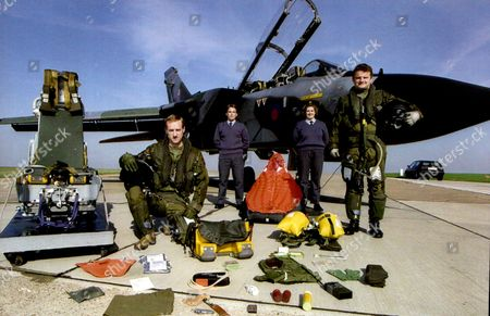 Editorial photo of A R.a.f. Tornado Crew And Their Survival Kit. Pilot Flt. Lt. Mike Baverstock (right Standing) And Navigator Flt. Lt. Bill Brand. Behind Them Are S.a.c. David Wright (left) And S.a.c. Sharon Hughes.