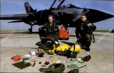 Stock Picture of A R.a.f. Tornado Crew And Their Survival Kit. Pilot Flt. Lt. Mike Baverstock (right Standing) And Navigator Flt. Lt. Bill Brand.