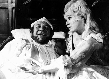 'Carry On Henry' Sid James and Barbara Windsor.