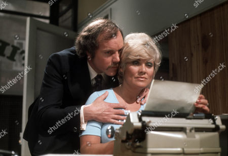 Kenneth Cope as Roche and Andria Lawrence as Topsy