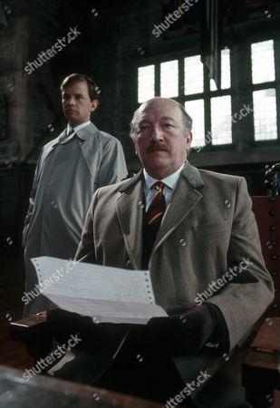 Simon Chandler as Fox and Robert Lang as Ferguson
