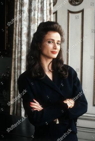 Tracy-Louise Ward as Miss Scarlett.