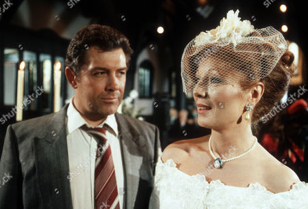 Lewis Collins as Jack Peacock and Rula Lenska as Mrs Peacock