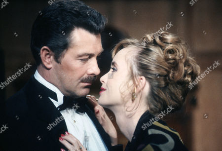Lewis Collins as Colonel Mustard and Lysette Anthony as Miss Scarlett