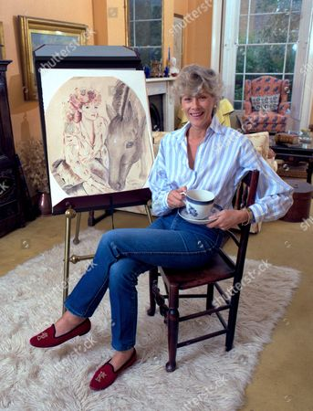 Sue Lloyd with one of her paintings at home in London, Britain