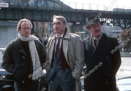 Michael Culver as Dicky Cruyer, Gottfried John as Erich Stinnes and Federick Treves as Frank Harrington