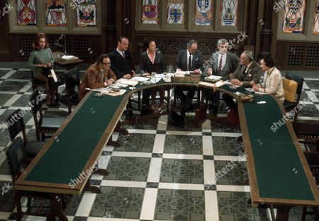 Christine Pilgrim as the secretary with, L-R, Emrys Leyshon as Michael Beamish, Glynn Edwards as Arthur Bentwood, Dorothy Alison as Ann Swink, Leonard Trolley as George O'Neill, Roddy Maude-Roxby as Norman Haggard, Anthony Nicholls as Henry Chandler and Elizabeth Ashley as Miranda Muir.