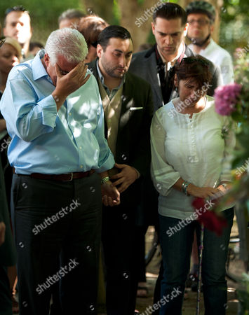 Amy Winehouse's father Mitch Winehouse (blue shirt), brother Alex Winehouse and mother Janis Winehouse