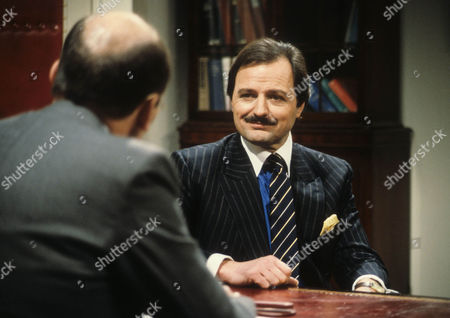 Garfield Morgan as Scrimshaw and Peter Bowles as Howard Booth